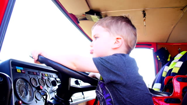 little fireman - fire engine stock videos & royalty-free footage