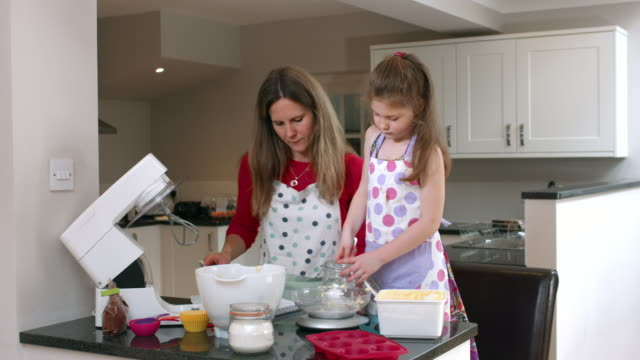 4K: Little Girl Adding Natural Sugar while Baking