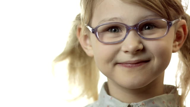 hd: little girl adjusting glasses on her nose - eyeglasses stock videos & royalty-free footage