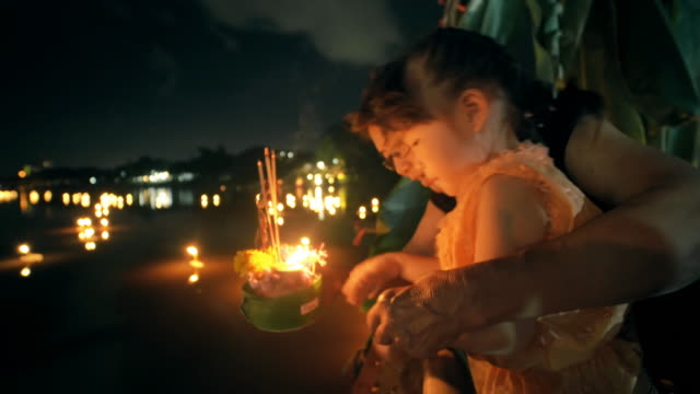 Little girl and grandmother in Loi Krathong Traditional Festival