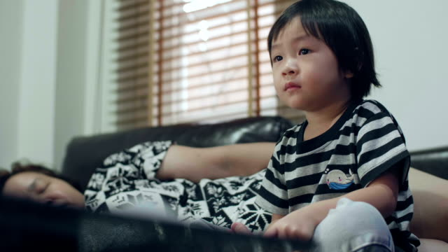 little girl and grandmother watching television - staring stock videos & royalty-free footage