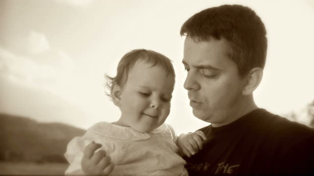 hd slow-motion: little girl and her father - sepia stock videos & royalty-free footage