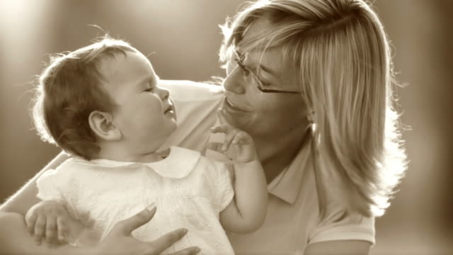 hd slow-motion: little girl and her mother - sepia stock videos and b-roll footage