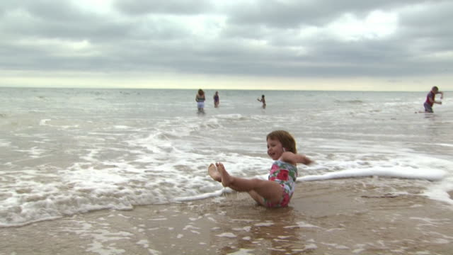 little girl at the beach - see other clips from this shoot 1156 stock videos & royalty-free footage
