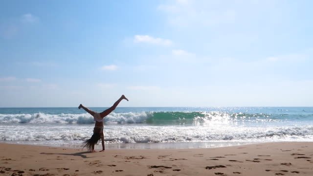 little girl beats in the back by the beach - gymnastics stock videos & royalty-free footage