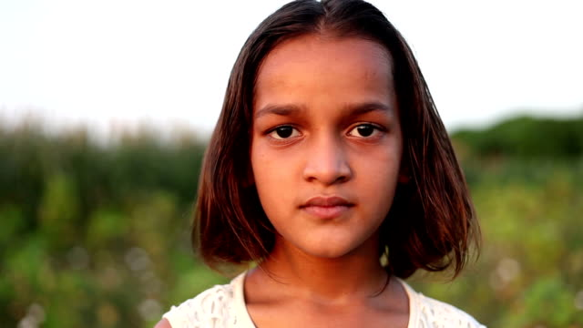 little girl blinking eyes & looking at camera - one girl only stock videos & royalty-free footage