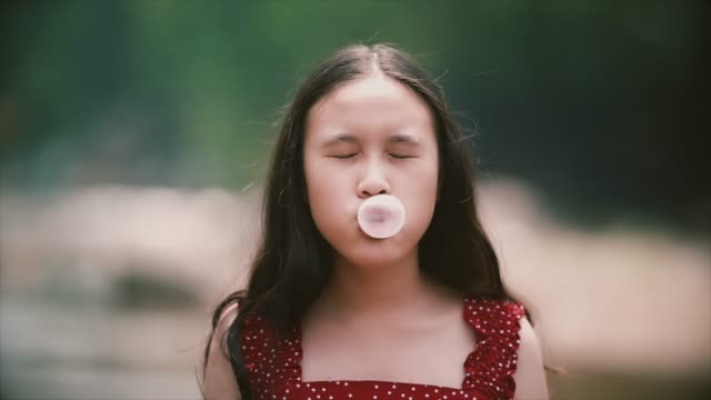 little girl blowing a bubble gum - bubble gum stock videos & royalty-free footage