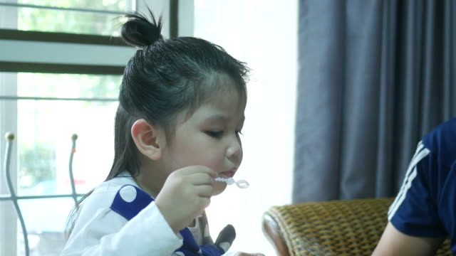 little girl blowing bubble - schoolgirl stock videos and b-roll footage