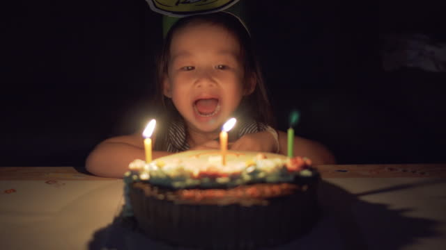 little girl blowing candle birthday 3 years old - 2 3 years stock videos & royalty-free footage