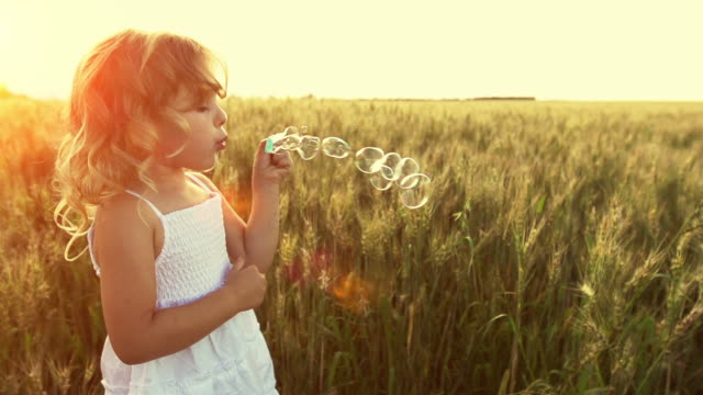 little girl blows bubbles - bubble stock videos & royalty-free footage