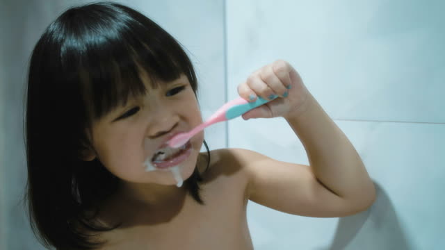 Little girl(4-5 years) brushing her teeth