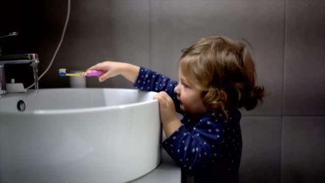 little girl brushing teeth - routine stock videos & royalty-free footage