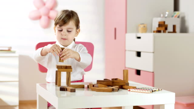 hd dolly: little girl building blocks - toy block stock videos and b-roll footage