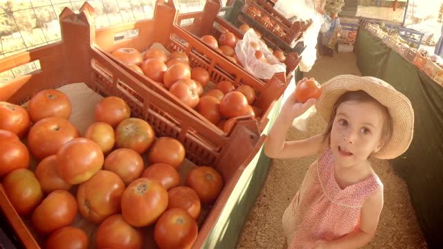 Little Girl Choosing Fruit At Farmers Market. Summer Resort