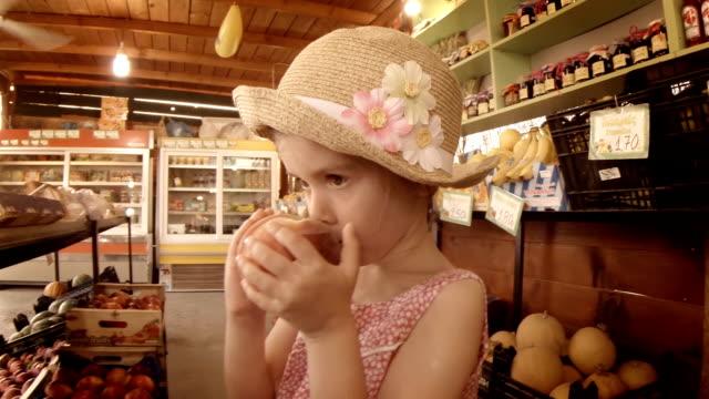 little girl choosing fruit at farmers market. summer resort - summer resort stock videos & royalty-free footage