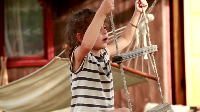 little girl climbing the rope ladder in the backyard - ladder of success stock videos & royalty-free footage