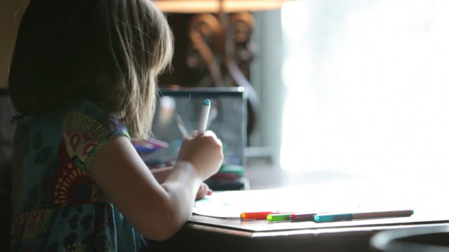 Little Girl Coloring a Picture
