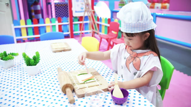little girl cooking sanwich - concentration stock videos & royalty-free footage