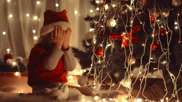 little girl covering her eyes with hands before getting a surprise christmas gift - babies only stock videos & royalty-free footage