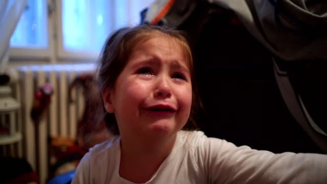 Little girl crying hard close up