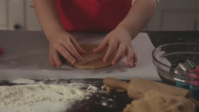 little girl cutting out shapes in a cookie dough - parchment stock videos & royalty-free footage