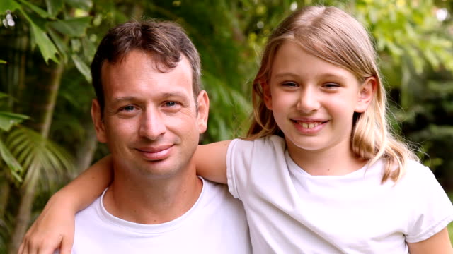 little girl daughter kissing her father on the cheek - arm around stock videos and b-roll footage