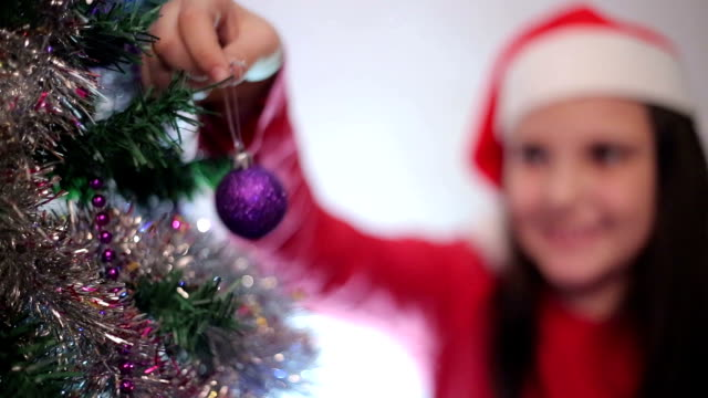 little girl decorates a christmas tree - little girls flashing stock videos and b-roll footage