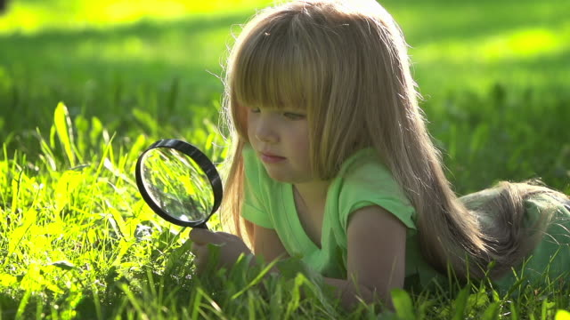 little girl discovers her world - magnifying glass stock videos & royalty-free footage