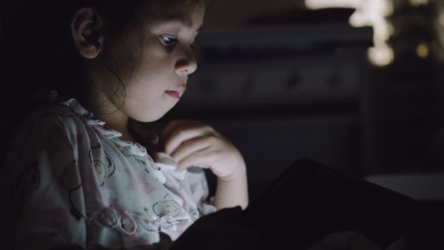 a little girl do homework on digital tablet. - darkroom stock videos & royalty-free footage