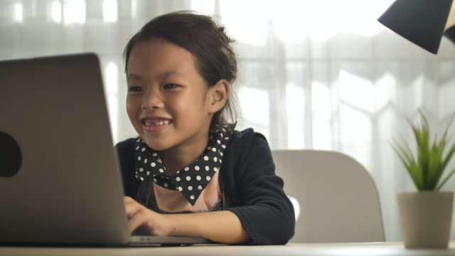 little girl do homework on the lap to at home - schoolboy stock videos & royalty-free footage