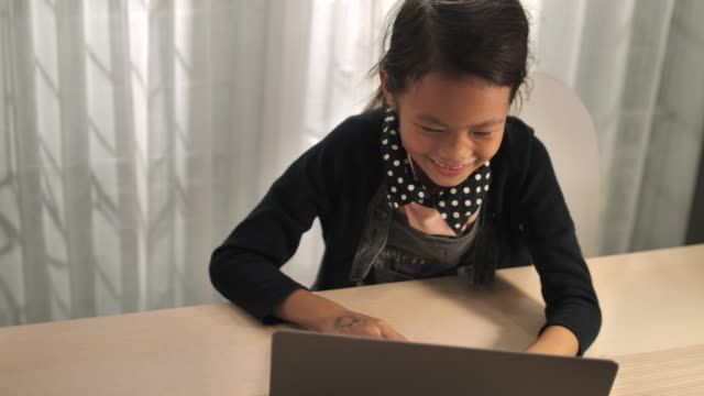 little girl do homework on the lap to at home - one girl only stock videos & royalty-free footage