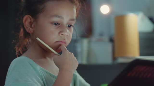 a little girl do homework with digital tablet. - study stock videos and b-roll footage