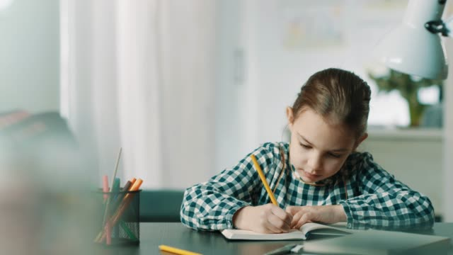 little girl doing homework - correspondence stock videos & royalty-free footage