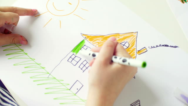 little girl drawing a house - pencil drawing stock videos & royalty-free footage