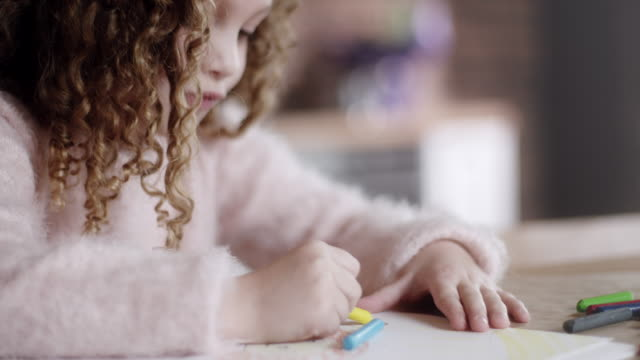 little girl drawing and coloring at kitchen table - colouring stock videos & royalty-free footage