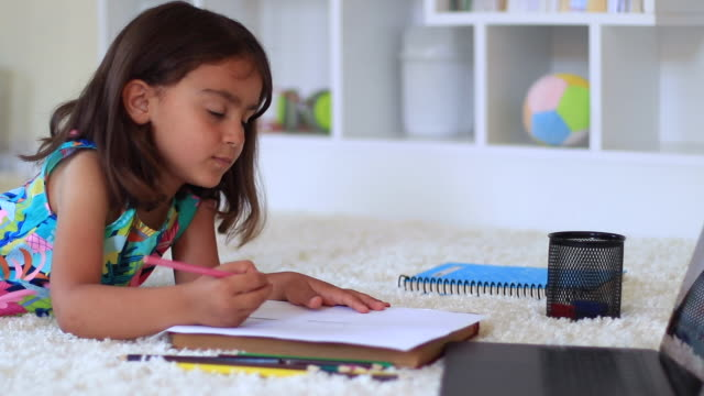 little girl drawing and painting from computer on the floor at home - preschool child stock videos & royalty-free footage