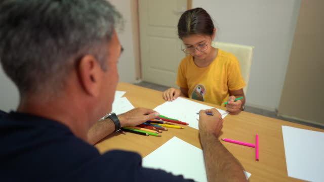 little girl drawing during occupational therapy session at rehabilitation center - invisible disability stock videos & royalty-free footage