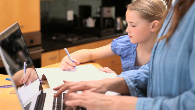 little girl drawing on her notebook - haarzopf stock-videos und b-roll-filmmaterial