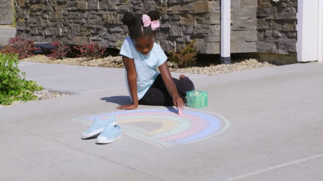little girl drawing with sidewalk chalk - symbols of peace stock videos & royalty-free footage