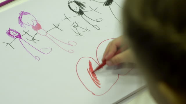 little girl draws her family - foster care stock videos & royalty-free footage
