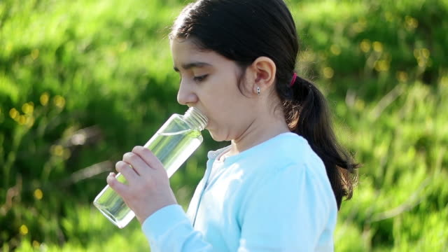 little girl drinking glass of water - drinking glass stock videos & royalty-free footage