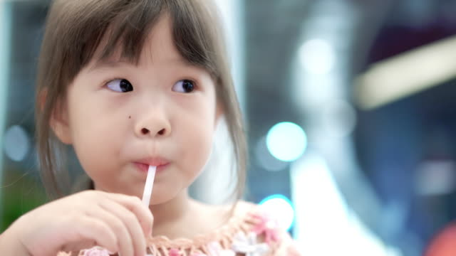 little girl drinking water through a straw - juice drink stock videos & royalty-free footage