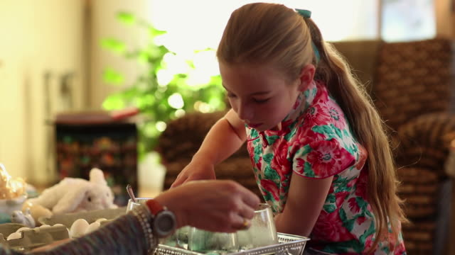 ms little girl dyeing easter eggs in color water  / lamy, new mexico, united states - lamy new mexico stock videos and b-roll footage
