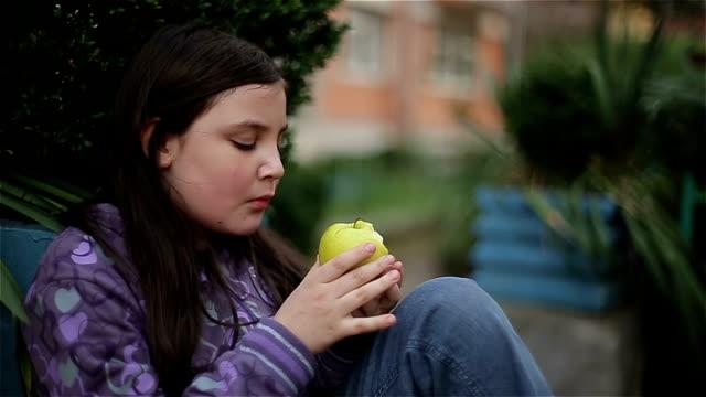 little girl eat green apple - eaten stock videos & royalty-free footage