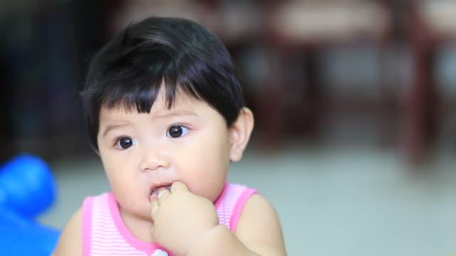little girl eat rice