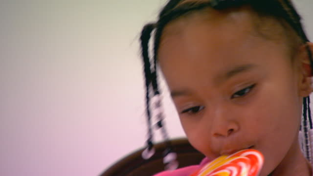 little girl eating a lolly pop  - lollipop stock videos and b-roll footage