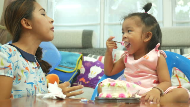 little girl eating birthday's cake with family - eating utensil stock videos and b-roll footage