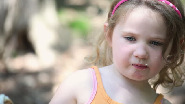 ms ts little girl eating hanging marshmallow on stick / toronto, ontario, canada - kelly mason videos stock videos & royalty-free footage