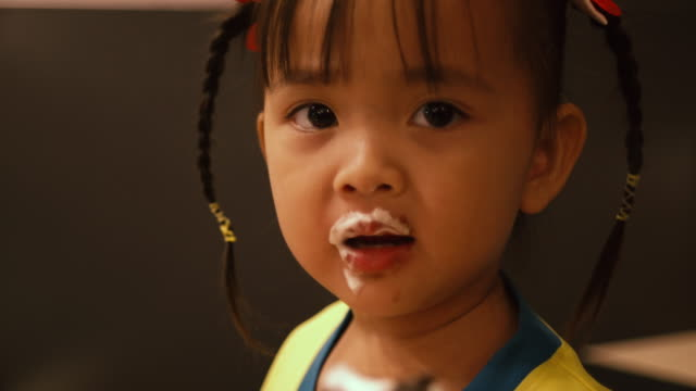 little girl eating ice cream - evening meal stock videos & royalty-free footage