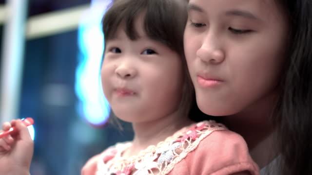 little girl eating ice cream - lingua umana video stock e b–roll